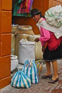 Woman on street of old town Quito